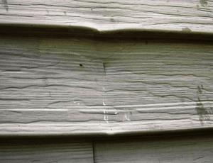hail damaged aluminum wall cladding