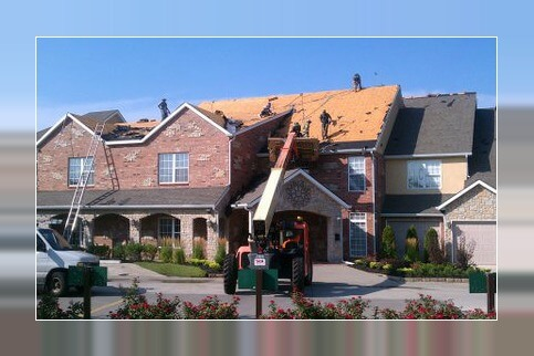 roofers working on townhouse building