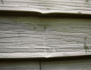 hail damaged aluminum wall cladding