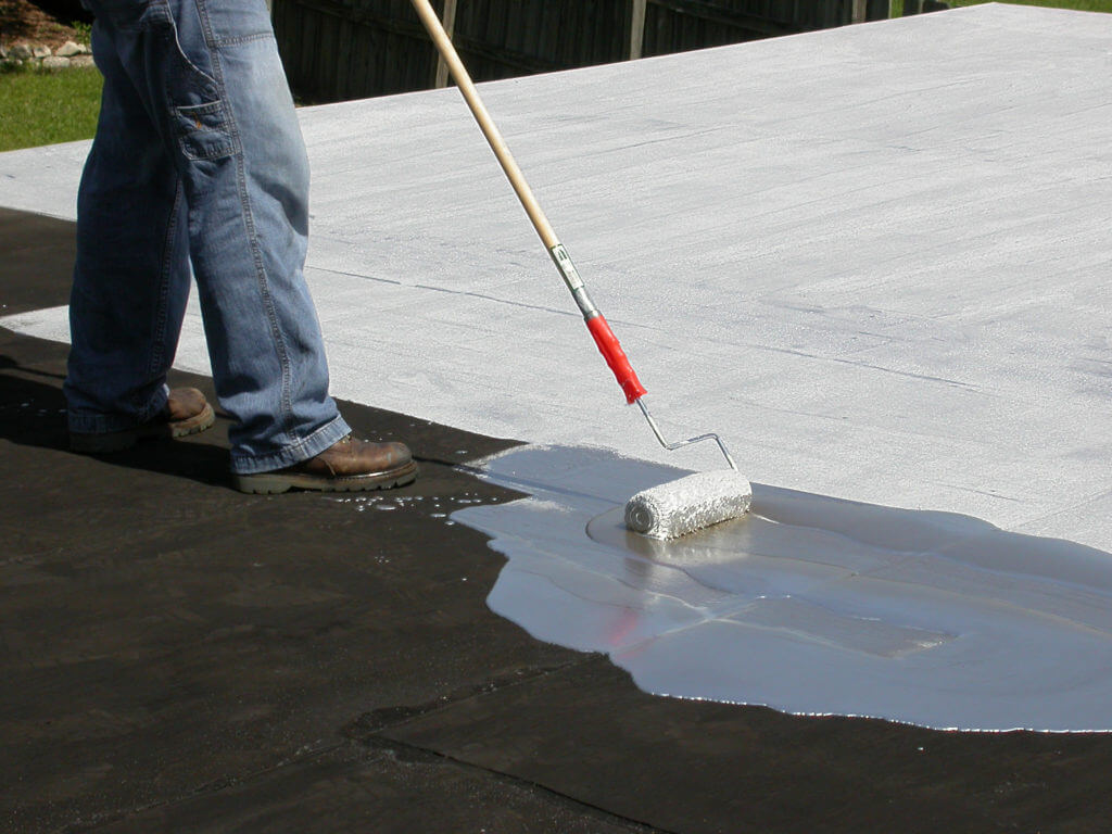Working installing coating on roof