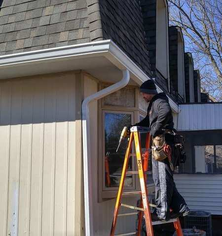 nate installing new gutters